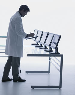 Doctor standing at computers